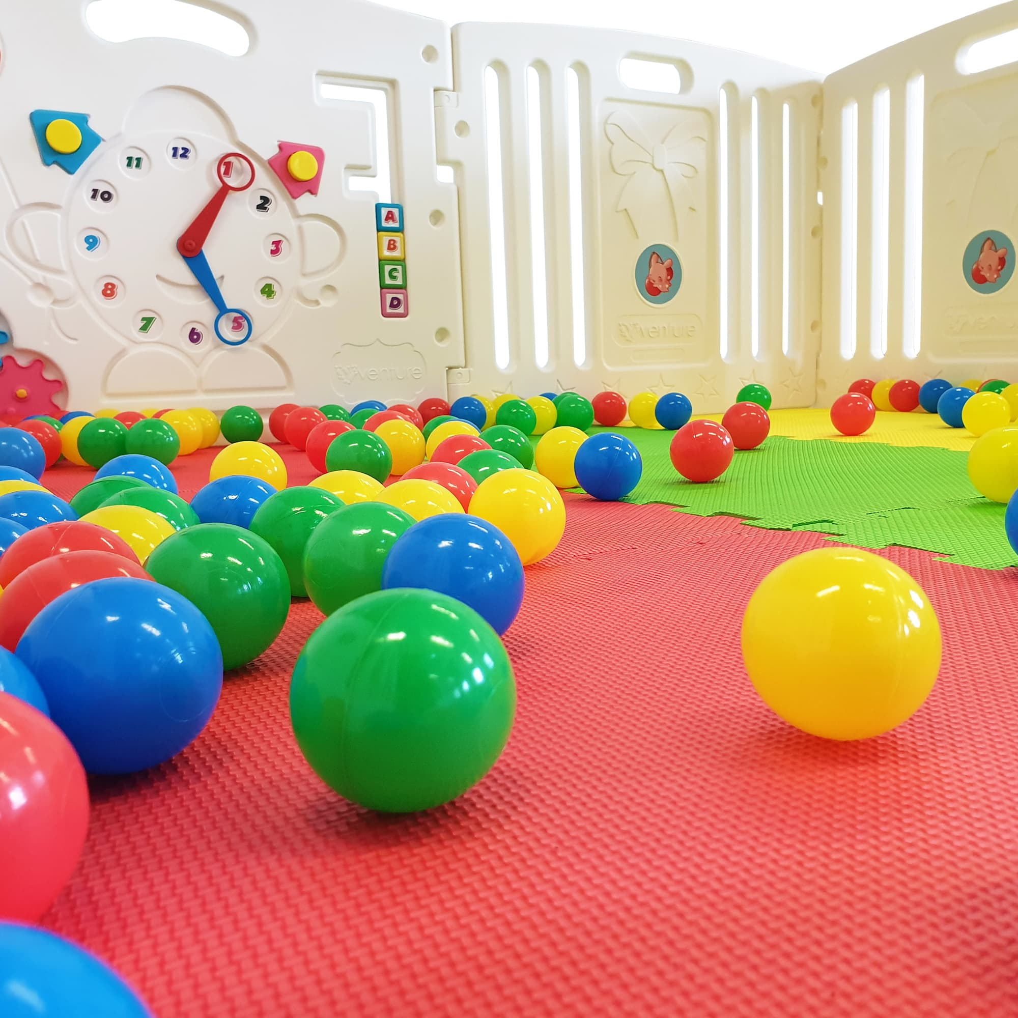 The playpen also includes child safe play balls.
