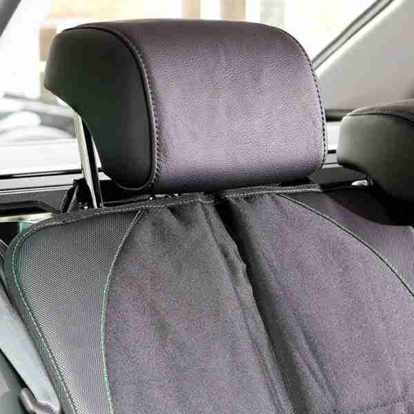 The car seat protector fastens to the cars headrest