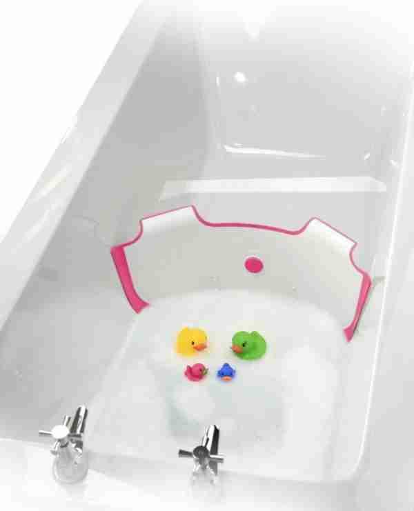 The BabyDam bathwater barrier in pink.
