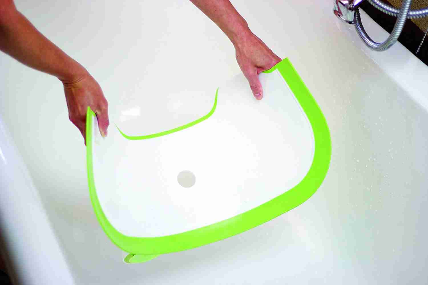 The bathwater barrier slots into your family tub to create a seat that stops water from seeping out.