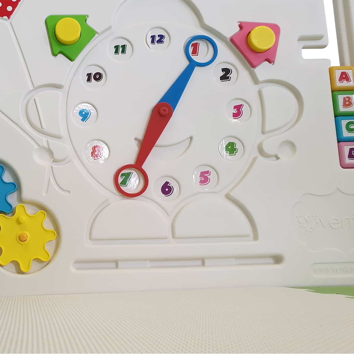 Turn the clock hands and learn with letters on the activity panel