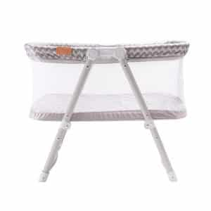 A stylish and compact grey travel crib