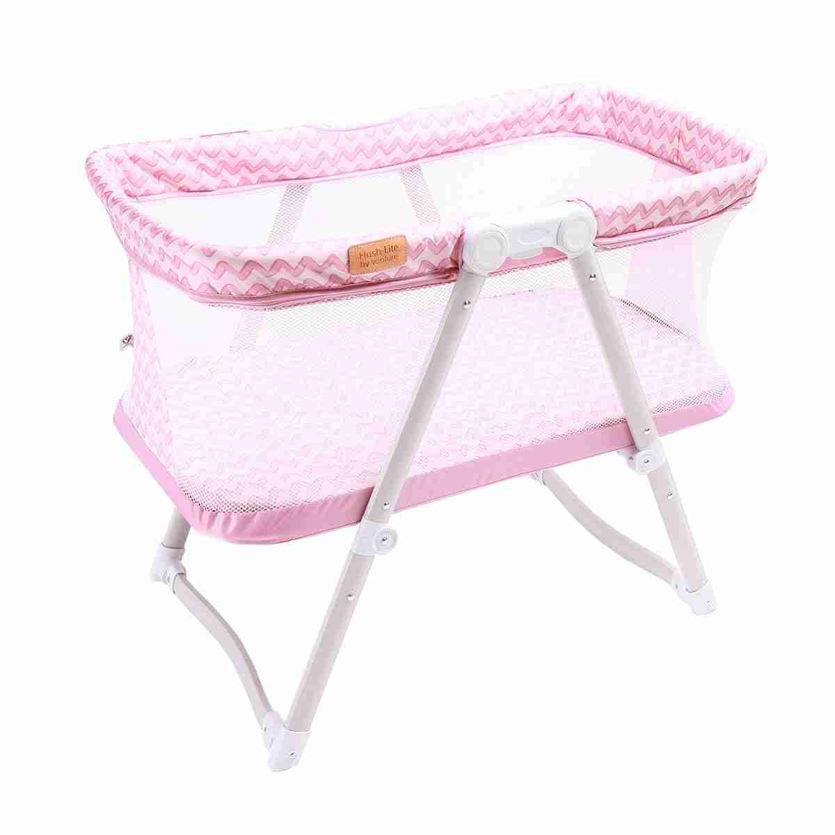 stylish travel crib in popping pink colour