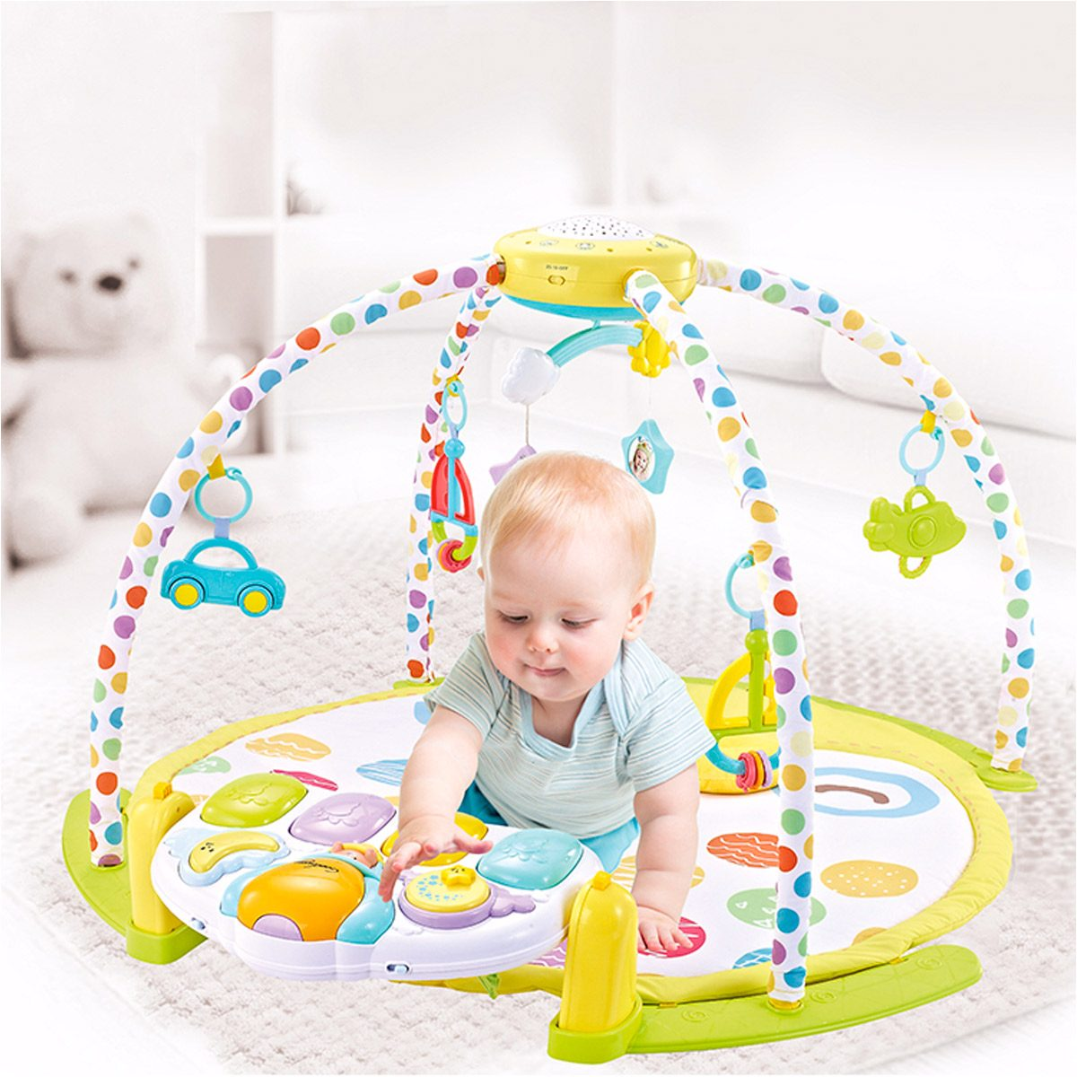 baby playing in activity gym